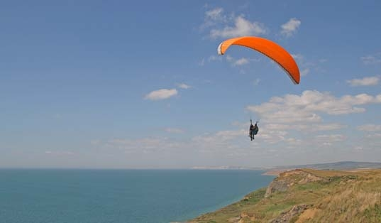 paragliding from the cliffs near Chale Bay Farm